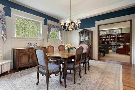 Dining room with view into family area Stock Photo
