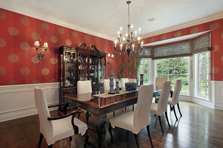 living room interior: Dining room in luxury home with red walls Stock Photo