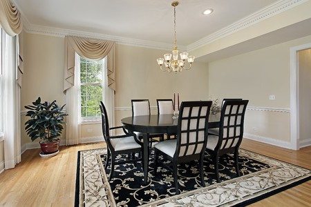 chandeliers: Dining room in suburban home with black table