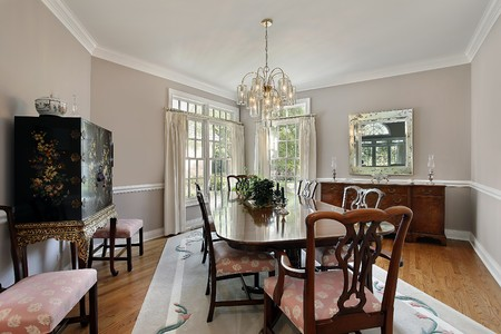 furnishings: Dining room in luxury home with gray carpet
