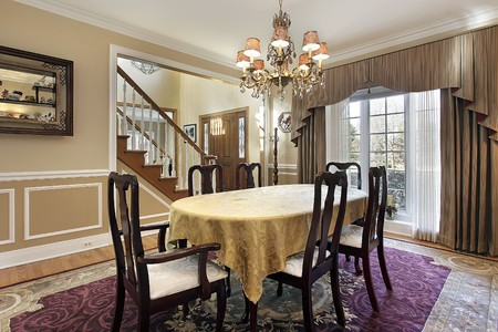 Dining room with tan walls and foyer view Stock Photo - 10292960