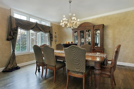 Dining room in luxury home with wood buffet photo