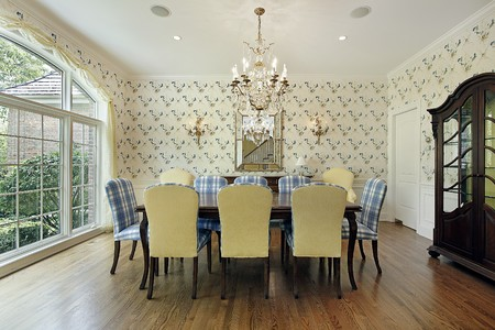 living room interior: Dining room with yellow and blue plaid chairs