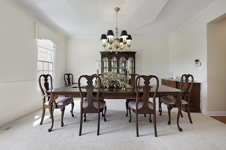 Traditional formal dining room with white carpeting photo
