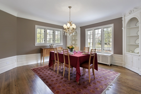 dining room: Dining room with built-in white wood cabinetry