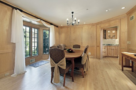 Dining room in luxury home with oak wood paneling photo