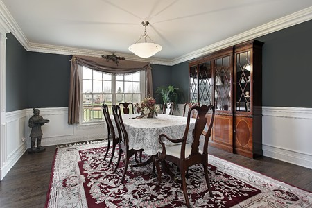 Dining room in luxury home with dark teal walls photo