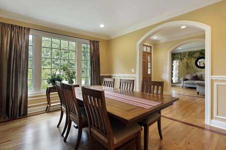 Dining room with yellow walls and foyer view