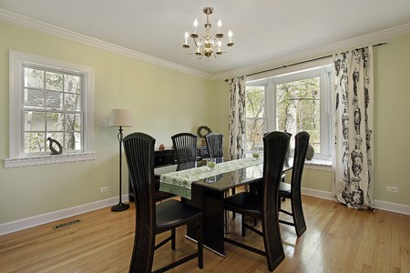 Dining room in suburban home with light green walls photo