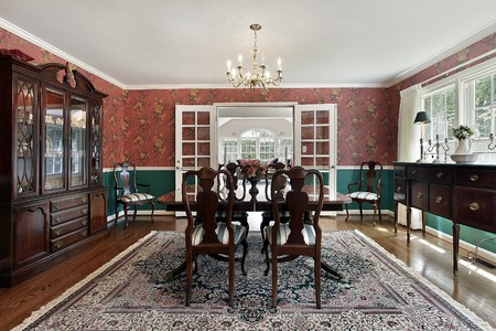 french doors: Formal dining room with french doors and red walls
