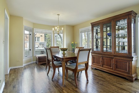 dining room: Dining room with large wood and glass buffet