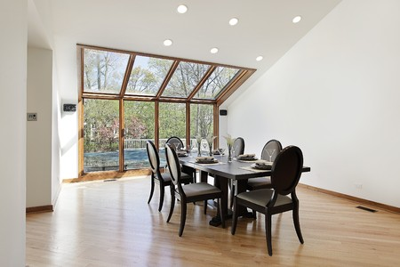 Large dining room with wood trimmed skylights photo