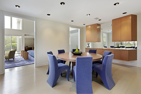 Dining room in luxury home with lavender colored chairs Stockfoto
