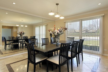 Dining room with black chairs and table photo