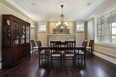 Dining room in luxury home with stone fireplace Stock Photo