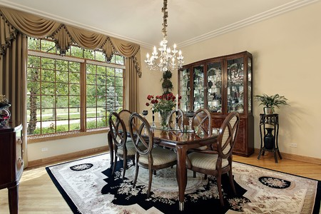 Dining room in suburban home with gold draperies