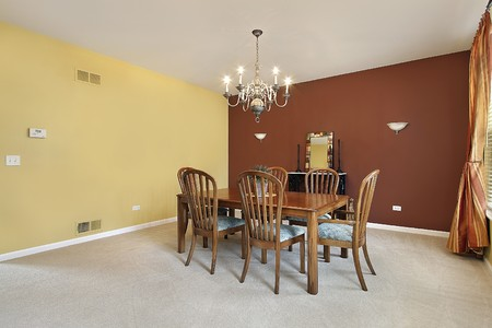 furnishings: Large dining room with yellow and copper colored walls