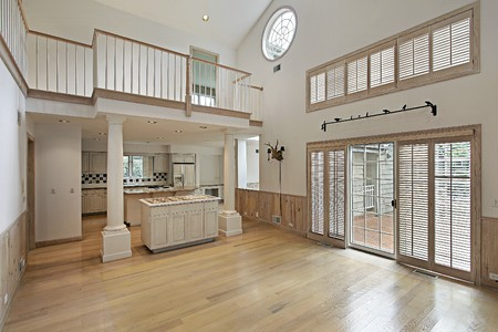 Family room with balcony and kitchen view