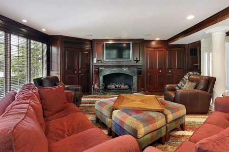upscale: Family room in luxury home with cherry wood cabinetry Stock Photo