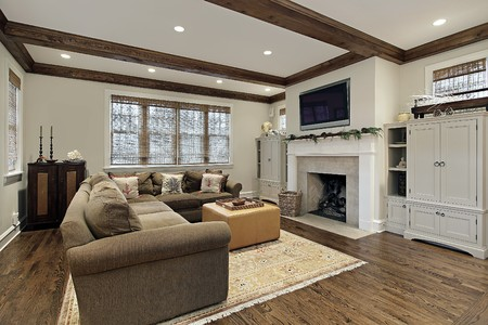 lighting fixtures: Family room in luxury home with wood ceiling beams