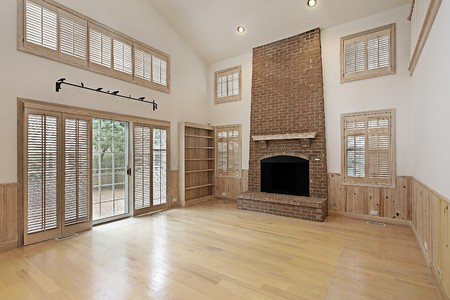 fireplace: Two story family room with brick fireplace Stock Photo