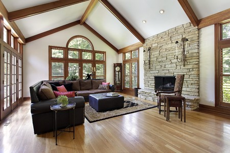 hardwood: Family room in luxury home with stone fireplace