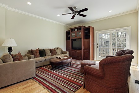 Family room in suburban home with door to deck photo