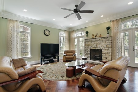 family  room: Family room in luxury home with stone fireplace