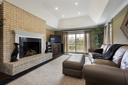 fireplace family: Family room in suburban home with brick fireplace