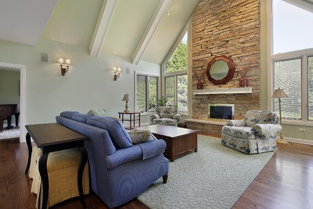 Family room with two story stone fireplace photo