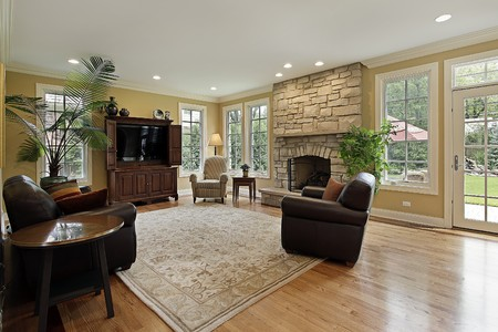 fireplace family: Family room in luxury home with stone fireplace