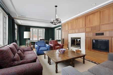 Family room in luxury home with wood paneled cabinetry photo