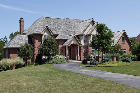 Large brick home with cedar shake roof photo
