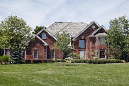 upmarket: Large brick home with large window above front door