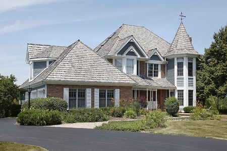Luxury home with turret and cedar roof Stock Photo - 10293085