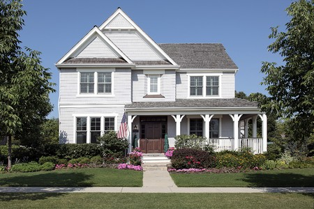 front porch: Home in suburbs with flowers and front porch
