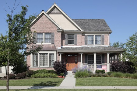 Brick home with front porch and cedar roof Stock Photo - 10293073