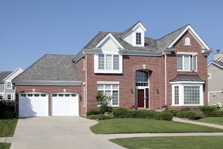 single dwelling: Brick home in suburbs with arched entry Stock Photo