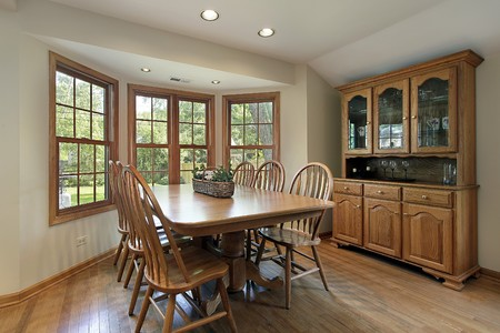 Breakfast area in suburban home with wall of windows photo