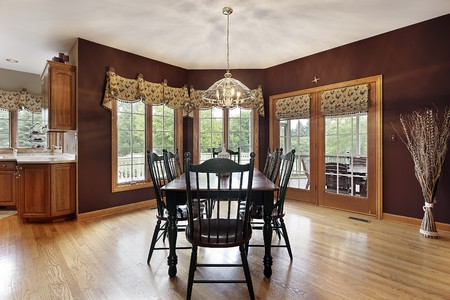 Large breakfast area in suburban home with doors to deck