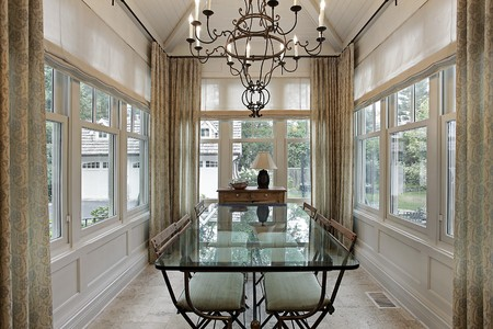 Breakfast room in luxury home surrounded by windows