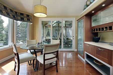 dwelling: Eating area in luxury home with wood cabinetry Stock Photo