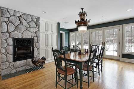 Breakfast room in luxury home with stone fireplace Stock Photo - 10293037