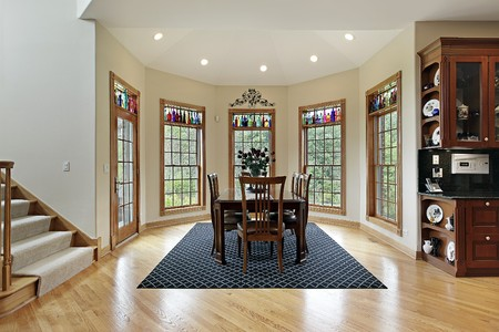 family  room: Breakfast room in luxury home with walls of windows