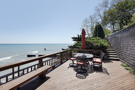 Deck outside luxury home with lake view Stock Photo - 10293111