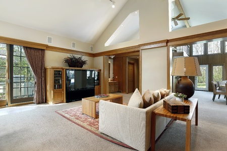furnishings: Family room in luxury home with wood trim