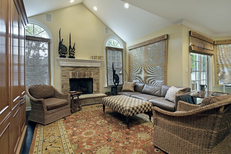 fireplace living room: Family room in luxury home with stone fireplace