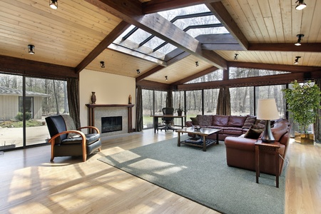 fireplace living room: Family room with wood beams and skylights Stock Photo