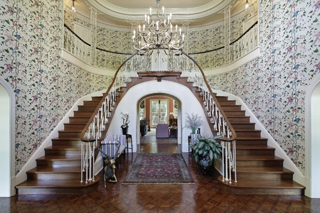 Large foyer in luxury home with double staircase Stock Photo