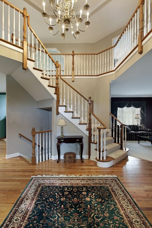 Foyer with wood trim railing on stairway Stock Photo